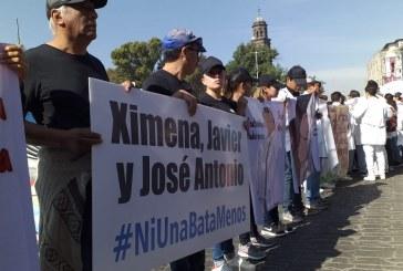 Universitarios visten de blanco y negro calles poblanas; exigen seguridad y justicia